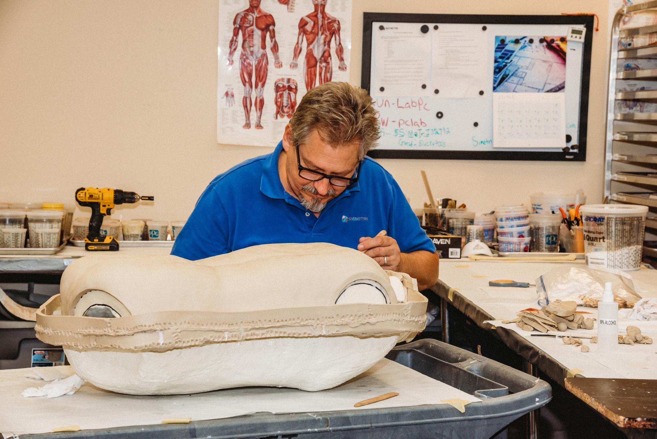 SIMETRI Special Effects Director Barry Anderson sculpts a medical simulation training manikin.